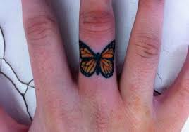 simple butterfly on finger tattoomagz