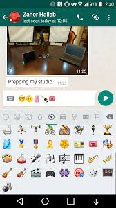 champagne iphone emoji sign of the horns whatsapp adds dozens of new emojis on android