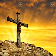 jesus on the cross in the sunset stock photo picture and