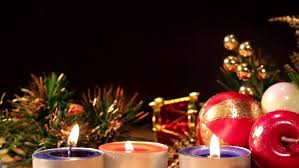 christmas decoration with tea light candle on wooden plank during