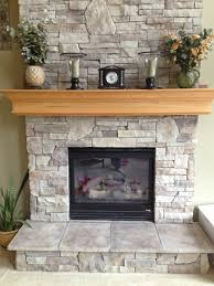 Painted Stone Fireplace Stunning Stone Fireplaces With Wood Mantels Under Decorative Oval
