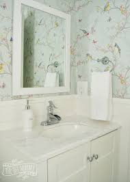 a powder room makeover with diy wallpaper and board u0026 batten the
