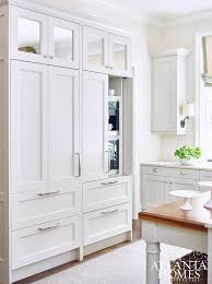 hidden coffee maker and microwave in pantry cabinets with fold in