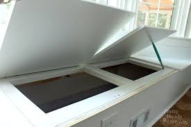 building a window seat with storage in a bay window pretty handy