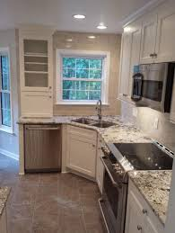 sinks contemporary kitchen with white paneled cabinet and corner