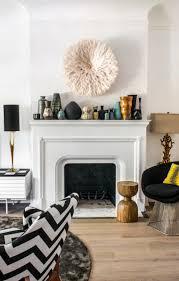 a beautiful fireplace vintage ceramics and a white bamileke