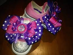 usinghair cls made the bows and put them on her sneakers using hair clips the