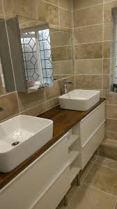 bathroom is ready natural stone travertine tiles oak worktop and