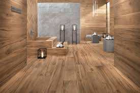 in a modern bathroom decorated entirely in wood grain porcelain