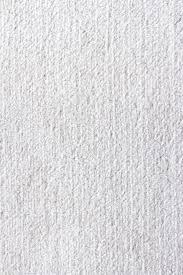 artistic wall art facing stylish blue leather sofa on white carpet