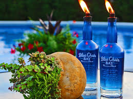 how to upcycle glass bottles into citronella torches hgtv
