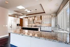 Granite Countertops With White Kitchen Cabinets by Alaska White Granite Countertops Design Cost Pros And Cons