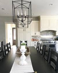 Modern Farmhouse Kitchen by Modern Farmhouse Kitchen With Large Table And Lantern Chandeliers