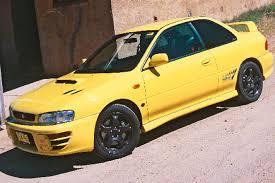 subaru turns the wick on wrx sti with 328ps s207 limited edition 100 subaru yellow 3dtuning of subaru impreza 5 door