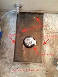 bathroom how to patch wood subfloor surrounded by gypsum