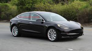 tesla to deliver the model 3 to its first batch of customers on