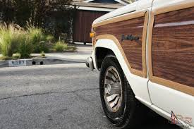 wood panel jeep wrangler jeep grand wagoneer w wood paneling white tan restored v8 woody