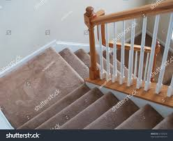 Wood Banisters And Railings View Down Stairway Modern American Home Stock Photo 31720576