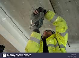 man drilling ceiling stock photos u0026 man drilling ceiling stock