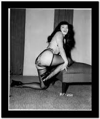 bettie kneeling pose mouth open lingerie stockings