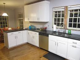 kitchen kitchen peninsula with seating glass pendant light