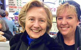 clinton spotted buying food for thanksgiving in local shop