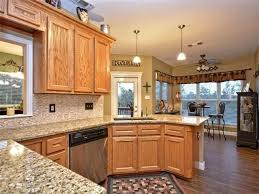 what color countertops with honey oak cabinets honey oak cabinets with dark hardwood floor birch cabinetry and