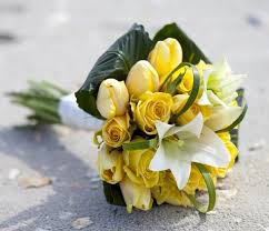 Popular Bridal Bouquet Flowers - a bouquet of yellow tulips white lilies and beargrass absolutely