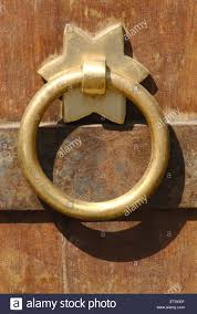 close up round decorative brass handle fitted on door vishrambaug