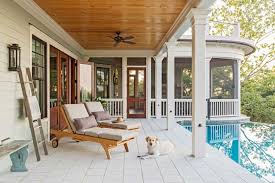 back porch light pavers and stained wood ceiling beach style