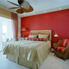 amazing bedroom decor with red wall paint and red brown pillows