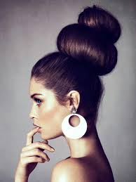 large hair avant garde hair style accented with large circle earrings