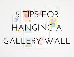 how to do a gallery wall tips tricks hanging a gallery wall the crafted life