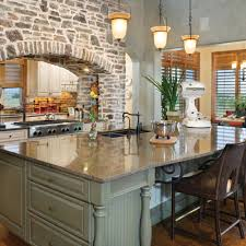 rustic traditional kitchen with brick arch and double sided stove