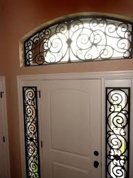 Sidelight Panel Blinds Beautiful Use Of Faux Iron For Side Lights And Arched Transom