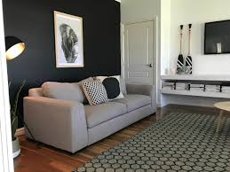 a black wall in the living room