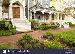 azalea blossoms and victorian homes savannah georgia usa stock