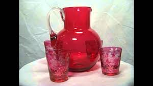 set of mouth blown vintage cranberry glass pitcher with four