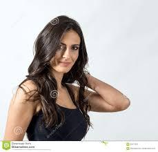seductive latino beauty with hand holding her healthy wavy