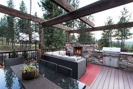 Rustic Outdoor Rugs Rustic Deck With Outdoor Kitchen By Copper Creek Landscaping