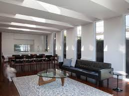 open floor plan sunken living room leather couch white chairs gray
