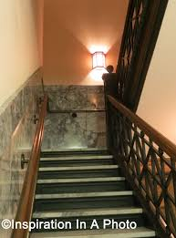 illuminating a stairwell with sconces inspiration in a photo