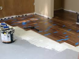 Removing Paint From Concrete Steps by Installing Hardwood Flooring Over Concrete How Tos Diy