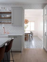 light gray kitchen with gray wash wood floors transitional kitchen