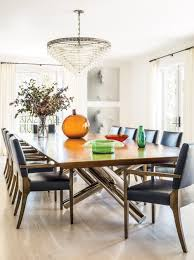 a minotti dining table with joseph jeup chairs in rich blue