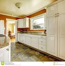 white kitchen cabinets orange walls orange kitchen room with white cabinets stock image image
