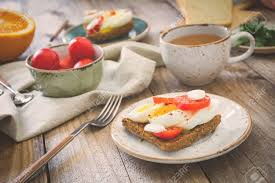 breakfast table healthy breakfast table toasts eggs fruits vegetables and