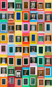 colorful windows from burano island italy stock photo picture