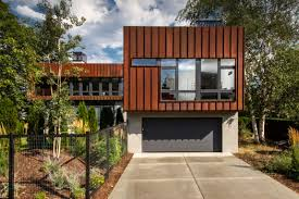 45 car garage concepts that are more than just parking spaces the wren residence which was designed by chris pardo design elemental architecture in missoula montana also has an l shaped floor plan the bike and car