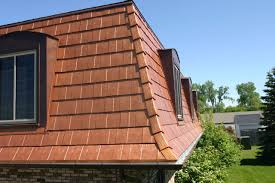 architecture metal shingles with many dormer windows on brick
